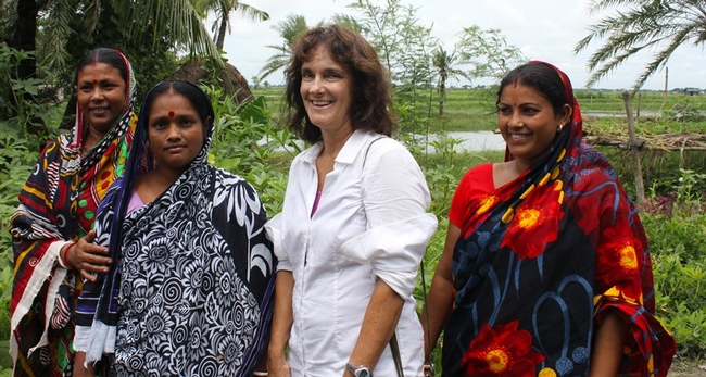 Beth Mitcham, second from right, shown with women in Bangladesh who are using the chimney solar dryer (designed by UC Davis faculty) to preserve fruits and vegetables from their homestead gardens. Photo by Amanda Crump.