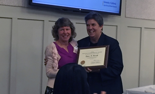 Diane Barrett receives research award from VP Glenda Humiston.
