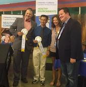 From left, UC IPM's Mark Takata and Chinh Lam, who won third place, with  Rina DiMare of the California State Fair, and Gabe Youtsey.