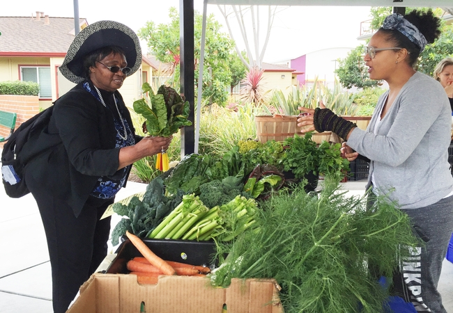 Mary Blackburn, UCCE advisor in Alameda County, shops at a farmers market.