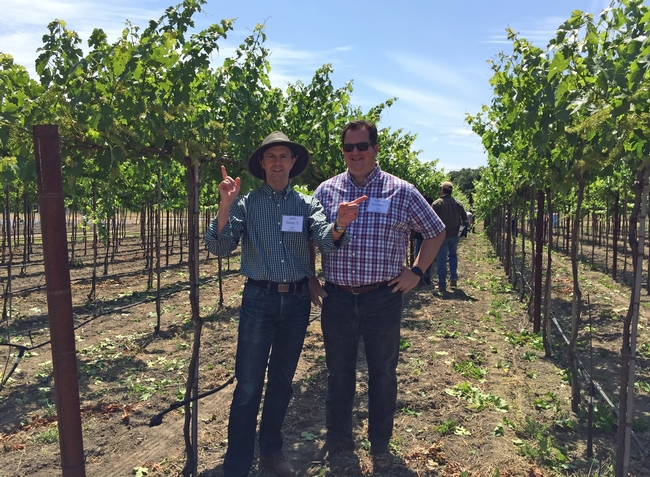 The VINE partner John Selep, left, joined Gabe Youtsey at a recent Grape Day at Oakville.