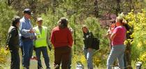 Glenn Nader, wearing blue cap, in the field with ranchers. for ANR news releases Blog