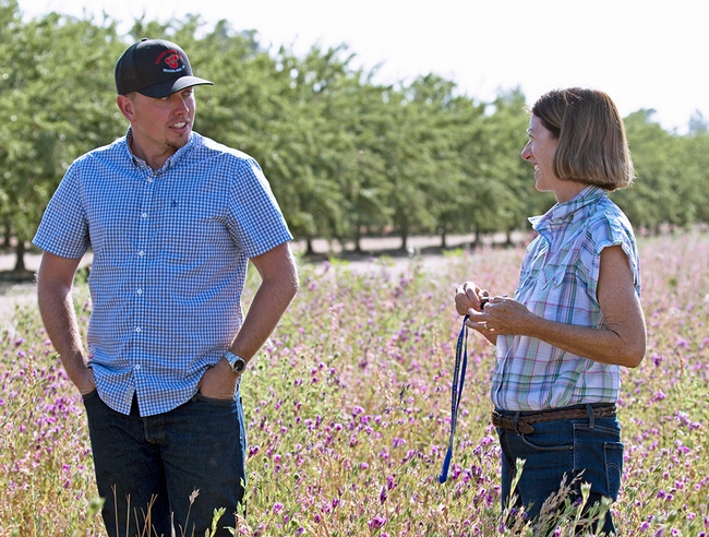 UCCE advisor Rachael Long, left, talks with a Yolo County grower about hedgerows. UCCE advisors serve Californians in one or more counties.