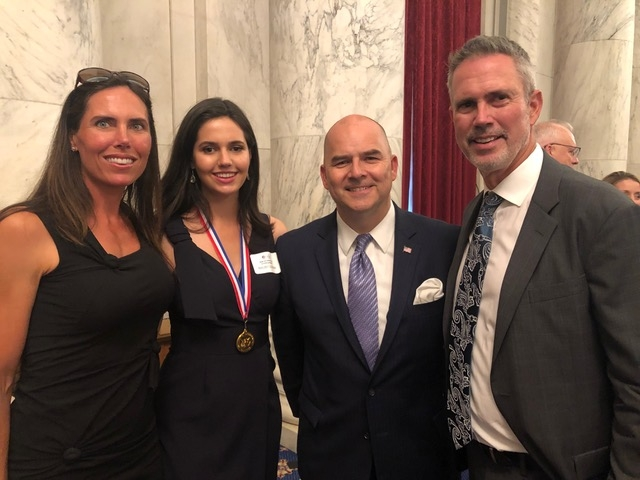 Elizabeth Sugarman, Sissy Sugarman, Ray Kerins of Bayer Corporation, and Shawn Sugarman at the Congressional Gold Medal award ceremony