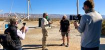 Cameron Barrows interviews Randy Buckmaster for the Climate Stewards Palm Springs windmill tour. Colin Barrows and Tracy Bartlett shoot video for the virtual field trip. Photo by Elizabeth Ogren Erikson for Green Blog Blog