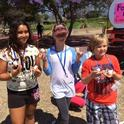 4-H Community Club members at Sustainable You! Summer Camp. Discovering alternative energy with solar oven s'mores.