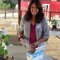Master Gardener (MG) Elaine Pepe-Williams prepares Plant-a-Seed Center