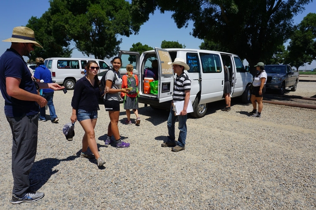 Traveling in two vans, 10 students, a teachers' assistant and two professors are following the course of California water.