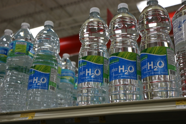 Image of bottled water on a store shelf from Pixabay.