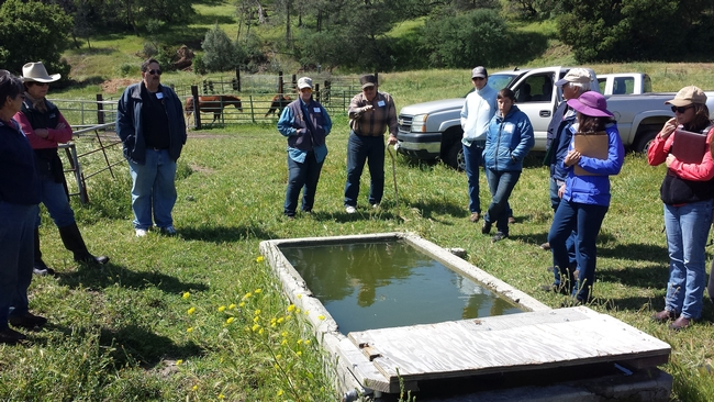 Joe Spencer explaining his wildlife friendly water trough design to workshop participants.