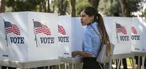 Destiny Martinez, 18, votes for the first time at the Power California early voting event and festival for students of the Los Angeles Unified School District on Oct. 24, 2018 in Norwalk. She said she liked the enthusiasm surrounding the day. Mindy Schauer / Orange County Register via Getty Images for Latino News Briefs Blog