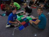 Three 4-H youth work together to assemble a blanket