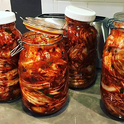 Kimchee in Jars (by Marcbarrington [CC BY-SA 4.0 (https://creativecommons.org/licenses/by-sa/4.0)], from Wikimedia Commons)