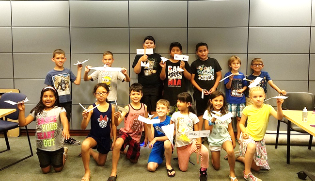 Youth at the Windsor Library Show off their gliders after participating in the