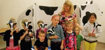 Judy Ludovice with junior farmers and Clarabelle the Cow for UCCE Sonoma Blog
