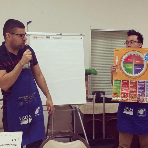 Nutrition Educators, Javier Miramontes and Tacu Vang reviewing Myplate with Participants at the Selma Senior Center.