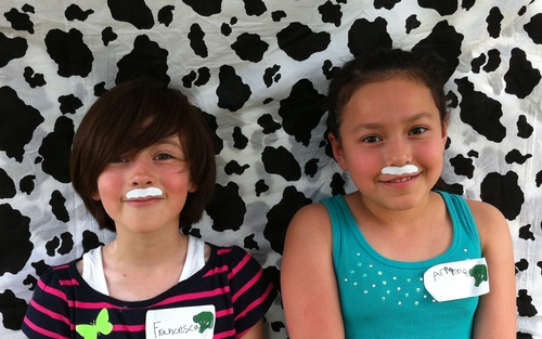 Francesca and Ariianna model their milk mustahes.