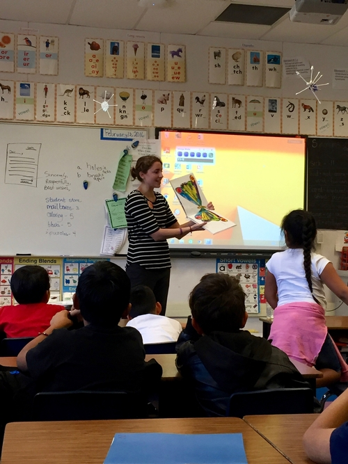 Kat reading The Very Hungry Caterpillar to 2nd graders at Yokomi Elementary