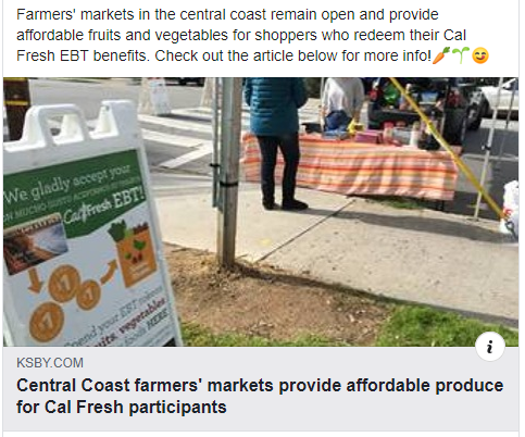 a sign posted at a farmers market that says We Gladly Accept EBT/CalFresh