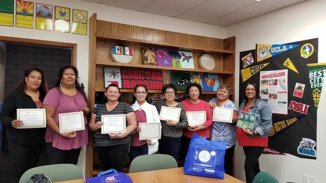 EFNEP Nutrition Educator Mariana Lopez (extreme right) Celebrating with her Graduate Participants
