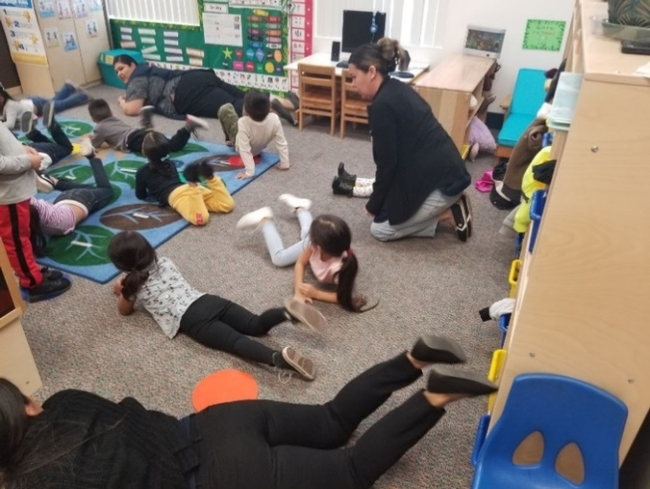 Students performing a CATCH ECE activity inside their classroom.