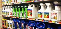 Pesticides on shelf. (Credit: Anne Schellman) for Pests in the Urban Landscape Blog