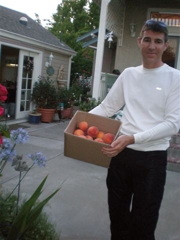 My son Joel with our peaches.