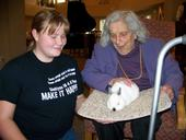 In one Siskiyou County 4-H activity, members visited residents of an assisted living facility with dogs and other animals.