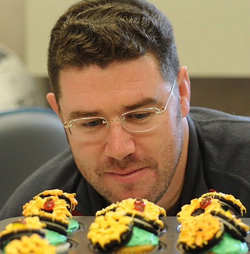 HMMMM--Randy Veirs of the UC Davis Department of Entomology, admires the ladybug cupcakes his wife made for the entomology office. (Photo by Kathy Keatley Garvey)