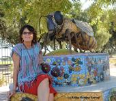 Donna Billick with her ceramic mosaic sculpture of a honey bee in the Haagen-Dazs Honey Bee Haven. (Photo by Kathy Keatley Garvey)