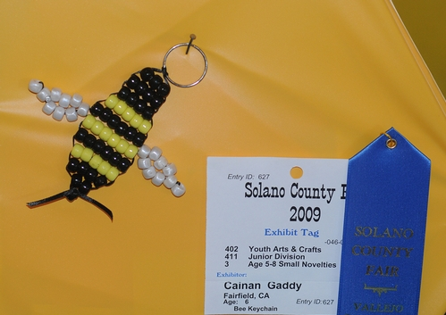 A HONEY BEE is transformed into a key chain at McCormack Hall, Solano County Fair. This is the work of Cainan Gaddy, 6, of Fairfield. (Photo by Kathy Keatley Gavey)