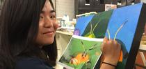 UC Davis student Kelly Aoyama works on a painting that will be displayed June 3 at a public art exhibit in Davis. (Photo by Diane Ullman) for Bug Squad Blog