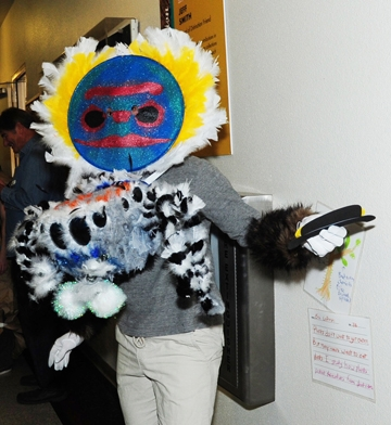 Wade Spencer, dressed as a peacock jumping spider, gets ready for a pinata game at the Bohart Museum Halloween party. (Photo by Kathy Keatley Garvey)