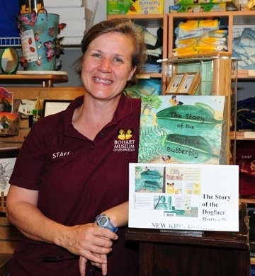 Entomologist Fran Keller, a Bohart Museum associate, with a children's book she wrote. It's illustrated by Greg Kareofelas and Laine Bauer. (Photo by Kathy Keatley Garvey)