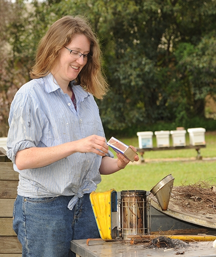 Liz Frost lights the smoker at the Harry H. Laidlaw Jr. Honey Bee Research Faciity. (Photo by Kathy Keatley Garvey)