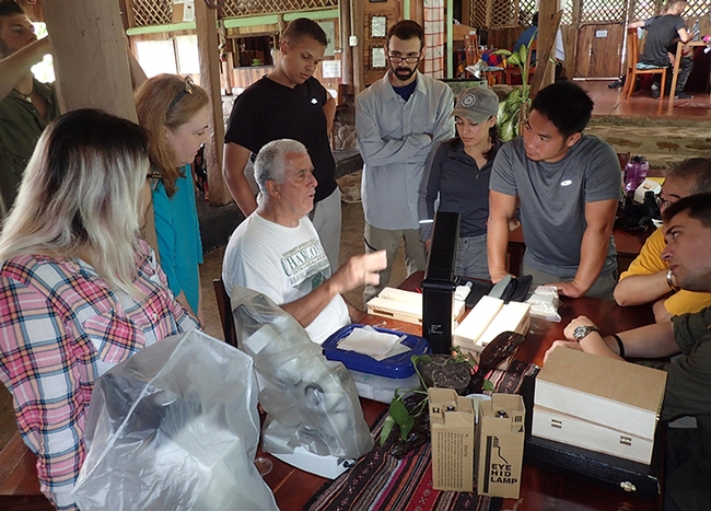 Entomologist Jeff Smith (center) who curates the moth and butterfly collection at the Bohart Museum of Entomology,   talks about butterflies at the Bohart's Belize summer expedition. (Photo by Steve Heydon)