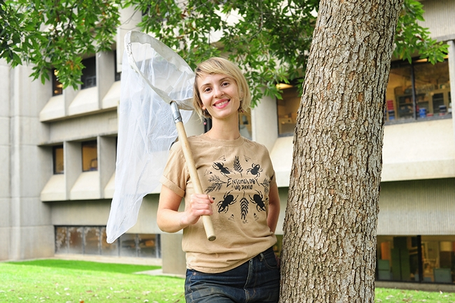 Entomologist Stacey Rice wearing her prize-winning t-shirt,
