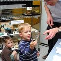 Joshua Trombly, 4, eagerly asks for insect identification at the Bohart Museum of Entomology. In back is his brother Daniel, 5. (Photo by Kathy Keatley Garvey)