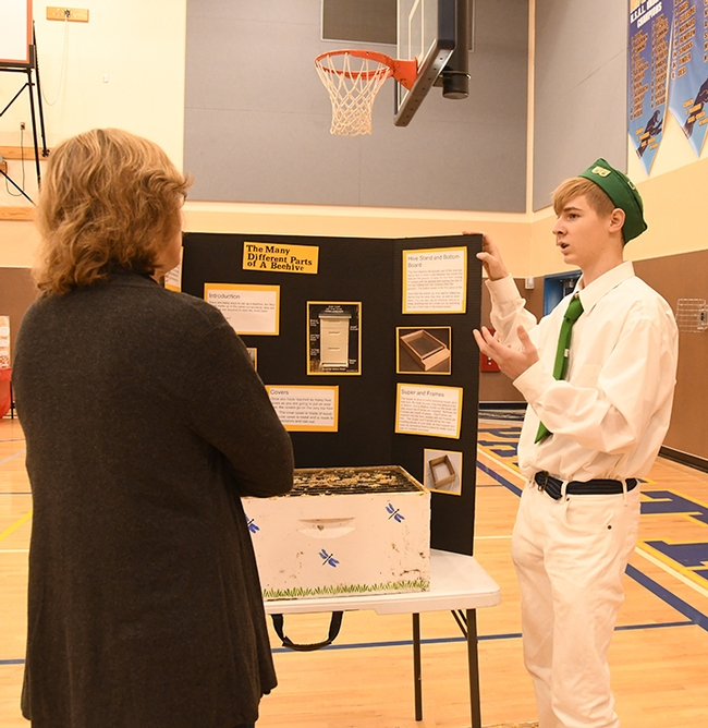 Vaca Valley 4-H'er and beekeeper Ian Weber answers questions from evaluator JoAnn Brown,  Suisun Valley 4-H Club project leader and community club leader. (Photo by Kathy Keatley Garvey)