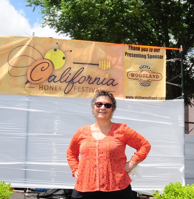 Amina Harris, director of the UC Davis Honey and Pollination Center, stands ready to greet visitors to the second annual California Honey Festival, set all day Saturday, May 5 in downtown Woodland. (Photo by Kathy Keatley Garvey)