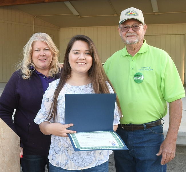 Fast forward to today: Mikayla Hagan (center) is the recipient of a college agricultural scholarship from the Friends of the Dixon May Fair. With her are scholarship chair Carrie Hamel of Dixon and Friends of the Fair president Donnie Huffman of Vacaville. (Photo by Kathy Keatley Garvey)