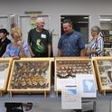 Entomologist Norm Smith (center) answers questions about moths at the Bohart Museum of Entomology's Moth Night. (Photo by Kathy Keatley Garvey)