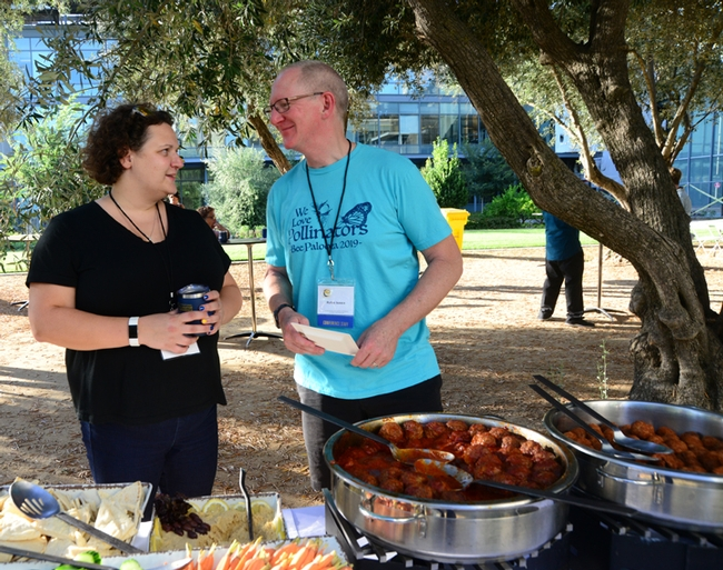 Extension piculturist Elina Lastro Niño of the UC Davis Department of Entomology and Nematology chats with the International Pollinator Conference co-founder Rufus Isaacs of Michigan State University at the Thursday reception. (Photo by Kathy Keatley Garvey)