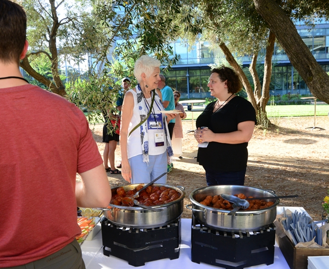 Pollinator champion Phyllis Stiles (left) of the Xerces Society for Invertebrate Conservation chats with Extension apiculturist Elina Lastro Niño of the UC Davis Department of Entomology and Nematology at the Thursday night reception. Niño and Professor Neal Williams are co-chairing the International Pollinator Conference. (Photo by Kathy Keatley Garvey)