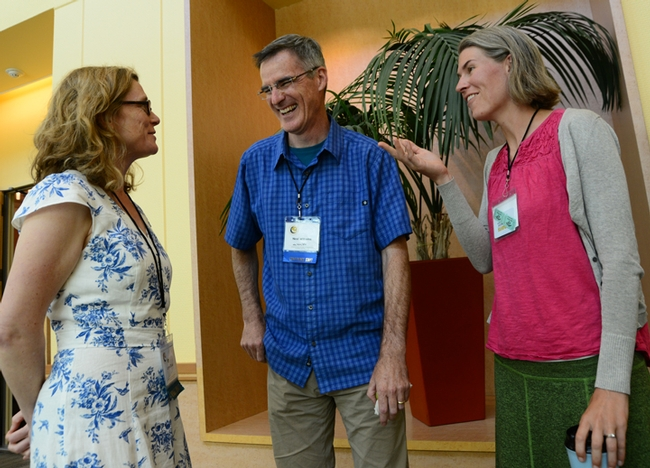 International Pollinator Conference co-chair Neal Williams shares a laugh with keynote speaker Lynn Dicks (left) of the University of East Anglia, UK, and speaker Rachel Vannette of the UC Davis Department of Entomology and Nematology. (Photo by Kathy Keatley Garvey)