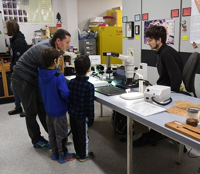Doctoral student Zachary Griebenow greets visitors eager to learn about ants. (Photo by Kathy Keatley Garvey)