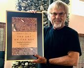 Eminent honey bee geneticist and biologist Robert E. Page Jr. with his new book,