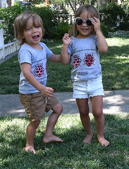 Cute as bugs in a rug. Twins Eli and Penny, pictured at age 3, wearing their ladybug t-shirts (Photo by Kathy Keatley Garvey)