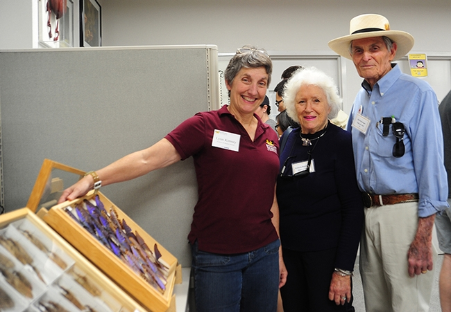Lynn Kimsey (left), director of the Bohart Museum of Entomology and professor of entomology at UC Davis, shows Richard and Evelyne Rominger a display at the Bohart Museum on UC Davis Picnic Day, April 17, 2015. The Romingers are both UC Davis alumni. (Photo by Kathy Keatley Garvey)