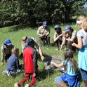 California Conservation Corps members at the UC ANR Hopland Research & Extension Center show a group of kids how to find herpetofauna like salamanders and skinks for a citizen science wildlife monitoring project.